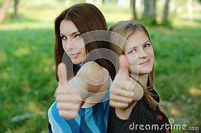 Two young women showing