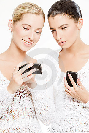 Two young women with smartphones