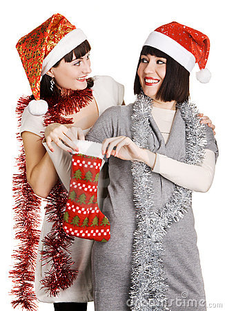 Two young women taking out their Christmas present