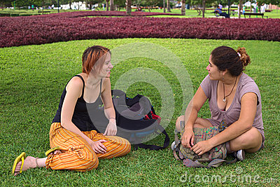 Two Young Women Talking in Park