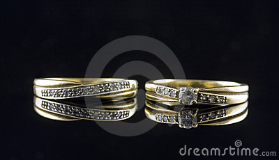 Twogold rings with gems
