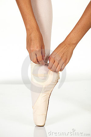 Tying ballet shoes
