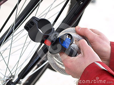 Tying a bike, closeup, isolated