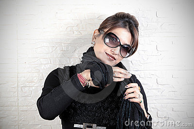 Tying woolen scarf