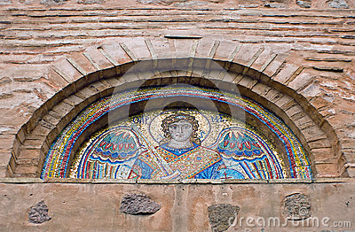 Tympanum with ancient mosaic of Collegiate Church