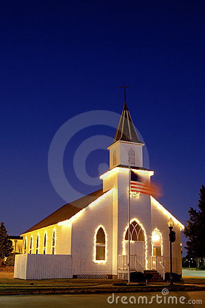 Typical american church with flag and blue sky
