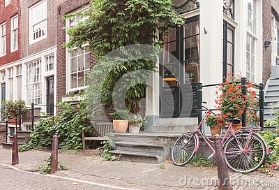 Typical Amsterdam old city street view with traditional buildings and vintage bicycle Stock Photo
