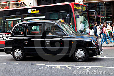 A typical black cab in Regent Street Editorial Stock Image