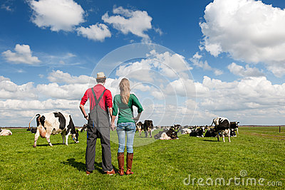 Typical Dutch landscape with farmers couple