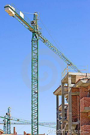 Typical Spanish building site with half built property and crane