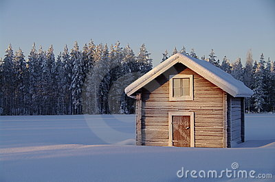 Typical swedish hut in winter