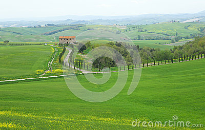 Typical Tuscany landscape with a farmhouse