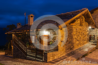 Typical village house in the province of Aosta Valley in Italy photographed at night