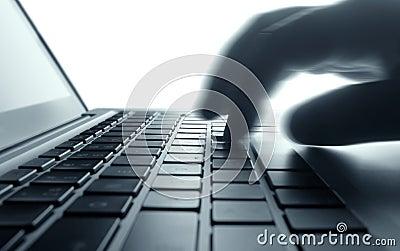 Typing on laptop keyboard.