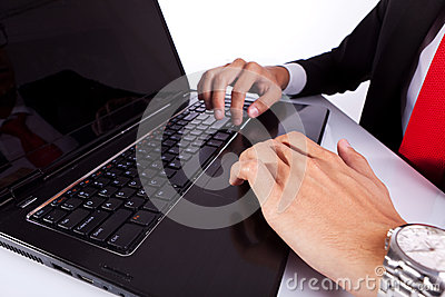 Typing male business man s hands on laptop