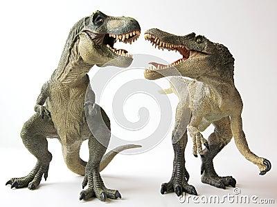 A Tyrannosaurus Rex Battles a Spinosaurus