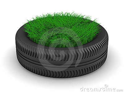 Tyre with grass on white background