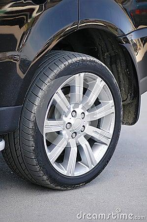 Tyre of a shiny black car