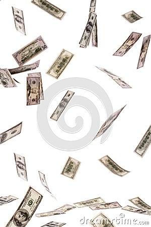 U.S. dollars bills flying through