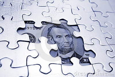 U.S. five dollar bill and puzzle
