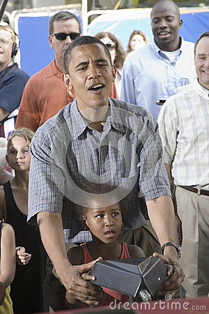 U.S. Senator Barak Obama with his daughter Editorial Stock Image