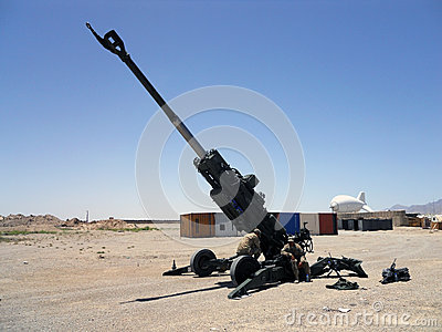 U.S soldiers fixing a big gun in Afghanistan Editorial Stock Photo