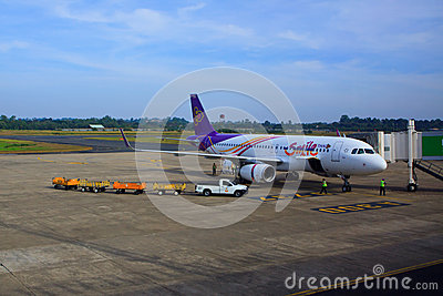 UBON  RATCHATHANI THAILAND - Nov21 - thai airway plane parking on gate way and preparing to flying at Ubon Ratchathani internation Editorial Stock Photo