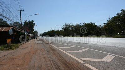 Buildind of Bangbuathong District Office Station in Nonthaburi, Thailand. UDON THANI, THAILAND - DECEMBER 17 : Thai people driving car on highway go to in Wat Pa stock video