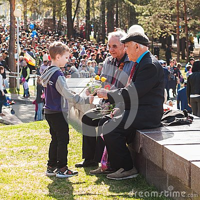 Free Ufa, Russia-may 09: The Boy Gives Flowers To War Veterans. Victory Parade. Royalty Free Stock Image - 109548636