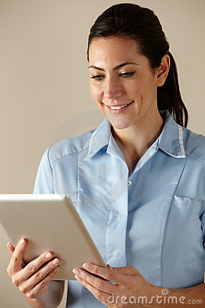 UK nurse using computer tablet