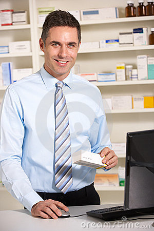 UK pharmacist at work