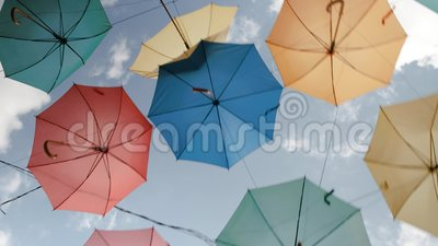 Ukraine, the city of Melitopol, August 2019. Multi-colored umbrellas are installed over the area. Ukraine, the city of Melitopol, August 2019. Multi-colored stock video