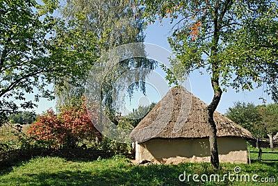 Ukraine. Kiev. Clay house with a thatch