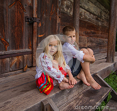 Ukrainian children near old wooden house