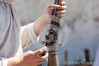 Antique gun in a hand Stock Photo