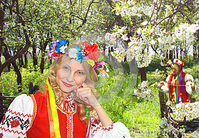 Ukrainian girl in national dress in a flowering garden