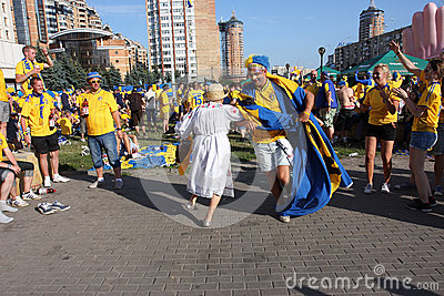 Ukrainian grandma dance with swedish football fans Editorial Photography