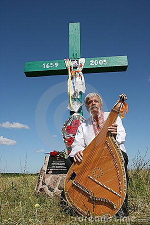 Ukrainian musician with bandura under cross