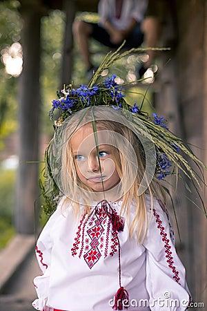 little ukrainian girl in circlet of blue flowers