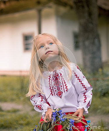 Little ukrainian girl watching magpie