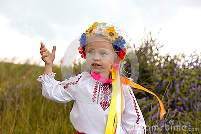 little ukrainian girl in circlet of flowers