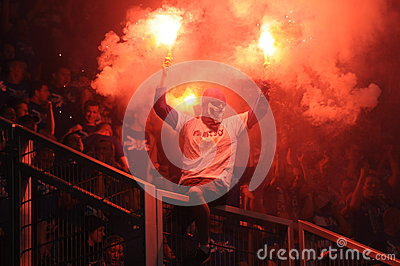 ultras hooligans supporters burn flares during match, Slask Wroclaw vs Lech Poznan on May 06, 2013 in Wroclaw, Pola Editorial Photography