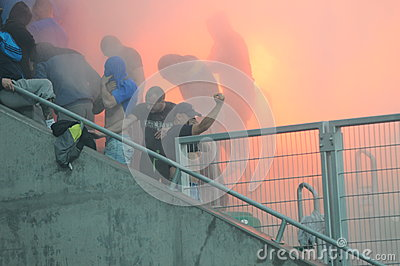 Ultras hooligans supporters burn flares during match Editorial Stock Photo