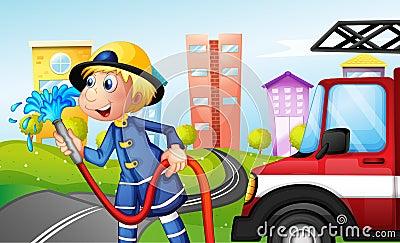 Um bombeiro com uma mangueira na rua