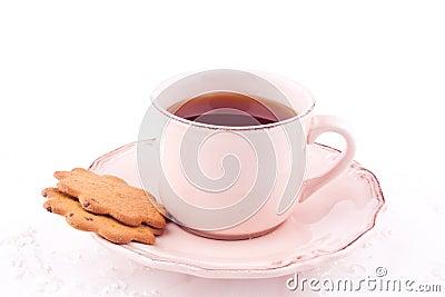 Um copo do chá e do biscoito