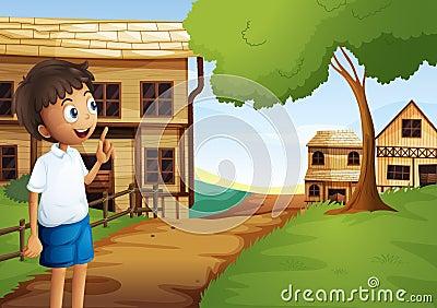 Um menino no caminho na vizinhança