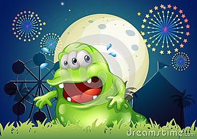 Um monstro verde suado na frente do parque de diversões