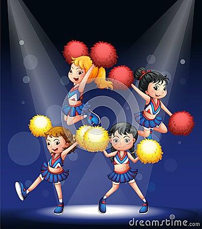 Um pelotão cheering com os pompoms vermelhos e amarelos