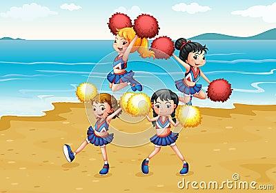 Um pelotão cheering que executa na praia