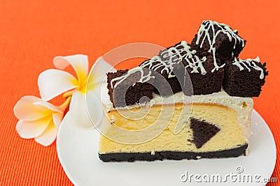 Uma parte de bolo de queijo da brownie